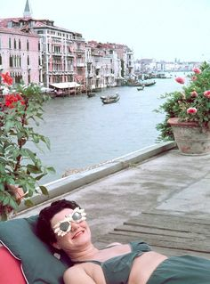 Peggy Guggenheim on the terrace of her palazzo, overlooking the Grand Canal, 1953. By Frank Scherschel/The Life Picture Collection/Getty Images.