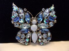 Regency Butterfly Insect Brooch Vintage Blue Glass Rhinestone Silver Plate Pin by AnnesGlitterBug on Etsy https://www.etsy.com/ca/listing/281639330/regency-butterfly-insect-brooch-vintage