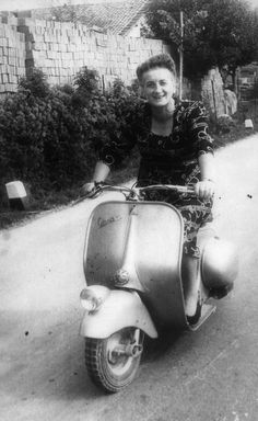 Italian old lady on her Vespa