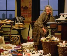 Credit:   Mike Laye/Corbis Angela Carter sits in her office before a typewriter with baskets filled with waste paper and books and papers at her feet.