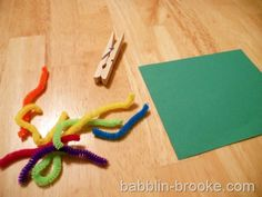 Worm pick-up. Move the worms to the grass with the clothes pin.