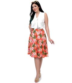 Will you answer when paradise calls, darling? Breeze along in this fabulous flare, a heavenly high waisted A-line skirt that's softly pleated and crafted in a lightweight scuba knit. This coral pink, tropical tinged separate boasts a pull on design and banded natural waist, patterned in vibrant hibiscus blooms throughout.  You've earned it, dear. <BR> Available in sizes S-L while supplies last.