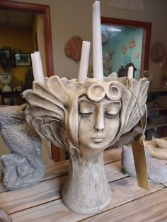 Lumiere head planter. This concrete head vase holds four tapered candles and a plant! Love it!!! Gotta get.