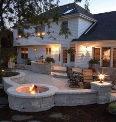 Tumbled block pavers create a fire pit and patio walls in this made-for-entertaining patio.