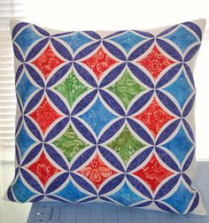 cathedral window cushion, how bright and gorgeous, I need to learn this technique