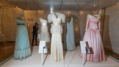 """A collection of dresses made by desingers Regimes in 1979 (L), Bruce Oldfield in 1990 (C), and Catherine Walker in 1987, all worn by  worn by Britain's Diana, Princess of Wales in Hong Kong in 1989, are pictured during a press preview of the forthcoming exhibition entitled """"Diana: Her Fashion Story"""", at Kensington Palace in London on February 22, 2017..Glittering gowns, elegant suits and bold mini-dresses worn by the late Princess Diana will go on show from Friday on the 20th anniversary of…"""