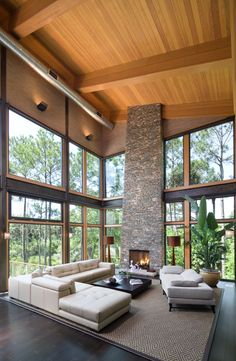 This Contemporary Living Room By Christopher A Rose AIA ASID Boasts Two Story Wood Ceiling Soaring Stone Fireplace Walls Of Glass Love It