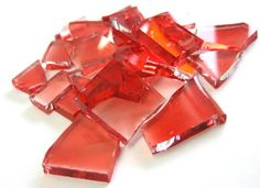 Pedras de vidro utilizadas para confecção de Mosaicos ,Bijuterias e/ou outras aplicações decorativas/ artesanais Pacotes de 50 G com pastilhas de vidro texturadas em vários formatos. * vidro c/ corte / pintura a frio  CORAL TRANSPARENTE R$ 6,50