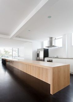 A huge kitchen island/dining table takes center stage in this apartment in Brazil. Felipe Hess has designed Apartmento Sergipe, an apartment for a young actor that lives in Sao Paulo, Brazil.