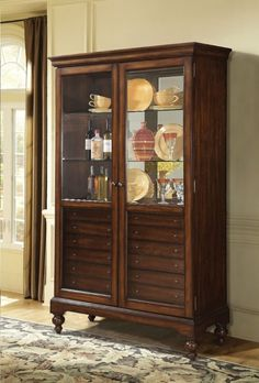 Dallin cherry finish wood curio cabinet with glass front doors. This cabinet features glass front doors, glass shelves and mirrored back with multiple drawers and turned legs. China Cabinets And Hutches, Curio Cabinets, Kitchen Cabinets, Glass Shelves Kitchen, Cherry Brown, Cabinet Dimensions, Tempered Glass Shelves, Acme Furniture, Cabinet Drawers