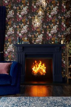 There's something quite mystical about black floral wallpaper, especially when combined with jewel colours and shiny metallics. A dark background elevates soft and pale flowers. The perfect choice for a cosy and inviting living room to snuggle into at the Wallpaper Please, Home Wallpaper, Moody Wallpaper, Painted Wallpaper, Wallpaper Online, Jewel Tone Bedroom, Jewel Tone Decor, Black Floral Wallpaper, Jewel Colors