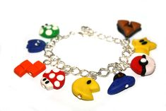 Gamer bracelet Pokemon Pokeball Pacman Mario Mushroom Zelda Tetris polymer clay charm bracelet on Etsy, $20.69