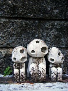 Kudama (Tree Spirit) statues- A kodama is a spirit from Japanese folklore, which is believed to live in certain trees (similar to the Dryad of Greek myth). Cutting down a tree which houses a kodama is thought to bring misfortune, and such trees are often marked with shimenawa rope.