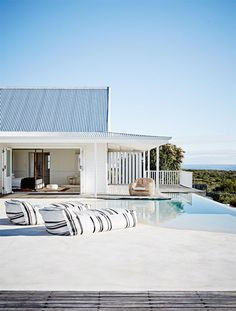 The swimming pool of a beautiful home in South Africa from the December 2015 issue of Inside Out magazine. Production by Sven Alberding/bureaux.co.za. Photography by Warren Heath/bureaux.co.za. Available from newsagents, Zinio, www.zinio.com, Google Play, play.google.com/..., Apple's Newsstand, itunes.apple.com/... and Nook.