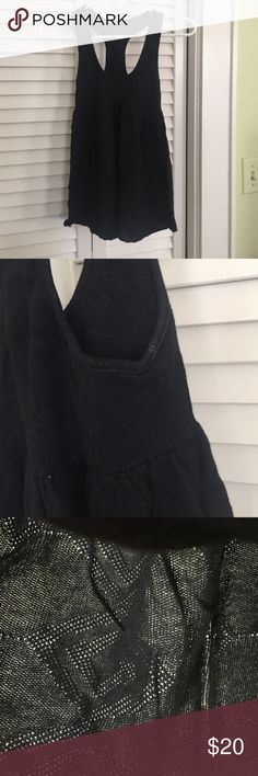 Free People Black Racerback Tank Size Small Cute casual racerback tank top from Free People.  Fabric has a really cool detail to it.  The top is tight around the bust and loose at the stomach.  Size small.  Happy to provide additional details! Free People Tops Tank Tops