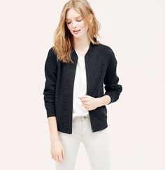 """Crochet lace adds a dash of sweet to this sporty bomber, done in soft French terry. Crew neck. Long raglan sleeves. Zip front. Ribbed neckline, cuffs and hem. Lined. 22 3/4"""" long."""