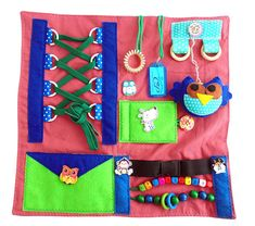 Welcome to ComfortablePlace. Buckle toy for 1 year old This sensory board is perfect for small fidgets. Develops fine motor skills of fingers. A felt elephant is attached to the rug. which also develops tactile sensations. With the help of beads, you can teach your child to count