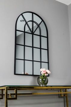 Our accent Arched Wall Mirror is a great way to add a sense of open space to your home with the arched window design and light reflecting mirrored glass. Simple and elegant, its delicate frame and window style is finished in black powder coated iron for a look that will beautifully harmonise with your existing decor. Dimensions: 100cm (H) x 60cm (W) x 2cm (D)