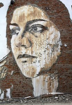 Wall face made by destroying bricks, by Vhils
