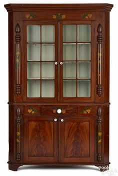 Winning bid:$4,800  York County, Pennsylvania painted pine corner cupboard, 19th c., probably by John Rupp, in two parts, retaining its original vibrant red grained surface with floral accents, 86'' h., 52 1/2'' w. - Price Estimate: $3000 - $4000