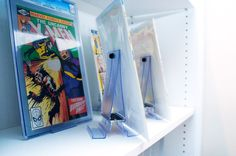 """NEW """"Two in One"""" comic book and collectible display that can be used as either a Wall Mount or Shelf Stand.  Finally a low cost affordable way to start displaying all of your collectibles and comic books. www.comicmount.com"""