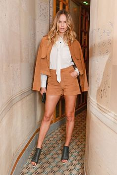 Natasha Poly celebrating her latest campaign with Frame Denim wearing a matching short-and-jacket combo.