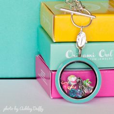 Origami Owl Beach themed locket. Large silver twist locket with O2 Blue face, beach ball, palm tree, flamingo, seahorse, April birthstone, Radiant Aqua, and Shimmering Blue charms. Order at DKirkpatrick.OrigamiOwl.com or donniellekirkpatrick@yahoo.com