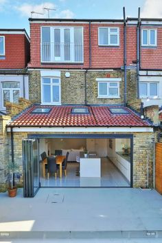 kitchen rear extension ealing with pitched roof: modern Houses by nuspace