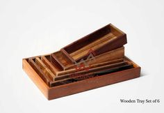 With style and rustic character, these wooden trays are a handsome set of home accents. Crafted from solid wood and finished in a natural brown color that highlights the natural beauty of the wood. Truly a unique set of trays that you are sure to love!
