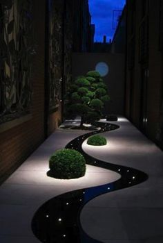 The Moon Terrace at the Connaught Hotel in London, England. Designed by English garden designer, Tom Stuart-Smith. The serpentine water feature with fiber optic lighting was constructed by Andrew Ewing. Photo by Kurosh Davis.