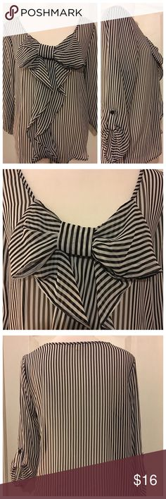 Cute Bow Front Blouse Black & white pinstriped semi-sheer blouse.  I love this little blouse but it's just that - little!  Marked Large, it's more like a Medium.  Especially if you're full busted.  Just trying to recoup my cost. Timing Tops Blouses