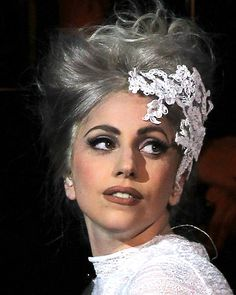 Lady Gaga's 25 Most Outrageous Hairstyles - Twisted Silver Updo with Lace Detail from InStyle.com