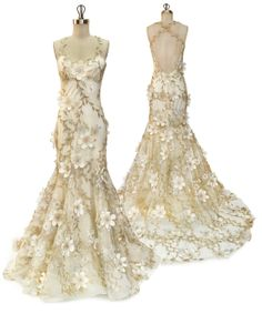 Wedding romance!  Gold vines and ivory flowers over tulle and silk.  Flora by Claire Pettibone.