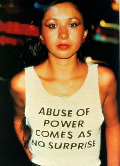"""Feminism -This is Lady Pink, one of the only female graffiti artists active in the Jenny Holzer, famous for her feminist postmodern """"Truisms,"""" designed this shirt and Lady Pink wore it around NYC. Someone needs to re-release this tee. Jenny Holzer, Barbara Kruger, Françoise Sagan, Robert Mapplethorpe, Nyc, Feminist Art, Azzedine Alaia, David Hockney, Postmodernism"""