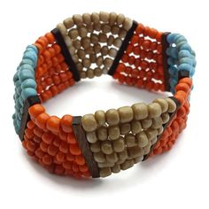 Turquoise orange handmade bracelet If what you are looking for is something out of the ordinary; this is it! This cool wavy shapped thick bracelet