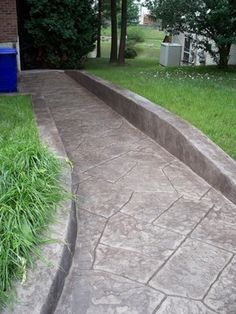 Exterior Wheelchair Ramp Design-don't like the uniform greyness to the ramp and the the concrete walls. Too industrial. But like the attempt at texture and more natural than straight up concrete.