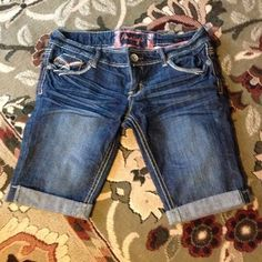 Long Shorts Embellished cuffed shorts. I have never worn these so they are in perfect condition. They have stretch to the material. Junior sizing Amethyst Jeans