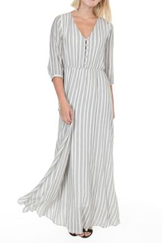 Soft, romantic cotton woven with stripes is such a sweetly classic shape for a summer dress! Lined in the bodice-front and skirt, this dress is easy to throw on with button front, bracelet-length sleeves, and gathered waist. 100% cotton body and lining. Choose from cream with black stripes, or off-white with blue stripes.   Provence Striped Maxi by Nymphe. Clothing - Dresses - Maxi Clothing - Dresses - Printed Los Angeles, California