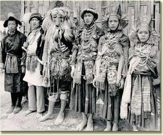 A photo depicting ceremonial dancers in Tibet. Given the dress of these people, ie. the sashes tied around their waists, this photo must have been taken in the lowlands, bordering Burma. The figure in the center is wearing a mask of a type that is associated with the highlands of both Nepal and Tibet. The man to the extreme left wears a hat that is typically Tibetan.