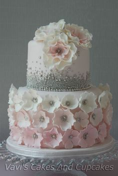 Woman 50th Birthday Cake. Flowers on the base of the cake are too large - out of proportion. But nice idea.