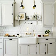 """We are getting close to point of the workshop being ready enough to move alllll the stuff out of The Little Cottage, and that has me in high """"inspiration collection"""" mode. I'm liking the double lights and the shelf over the sink from this @housebeautiful kitchen. We too have a very similar set up with the way the cabinets are hung, and no window over the sink, so I'm contemplating ideas for that. I'll file this one away for sure."""