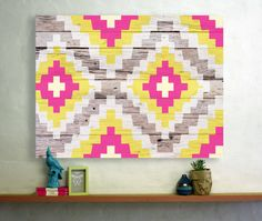 Aztec adds a touch of tribal chic to your home with it's bright Aztec pattern and aged wood background. Printed onto 100% cotton canvas this design comes in three sizes 30x40cm, 60x90cm and 90x120cm, ready to hang in your home. Canvasses are made to order and take approx 2-4weeks to be delivered.