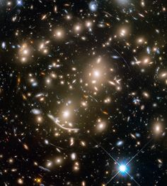 New deep-space images from the Hubble Space Telescope reveal hundreds of galaxies in the cluster Abell
