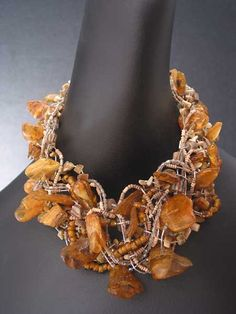 bazylistudio... even though amber weighs less than most stones, this necklace has to weigh a lot.  However, it is gorgeous!