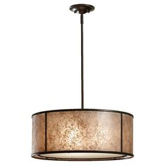 This drum shade pendant has a beige shade that looks like mica mineral. Organic feel for any room in the house. Like this find it and more here.