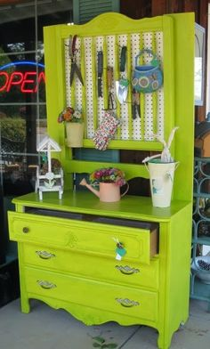 A brightly painted vintage dresser was converted into a planting station. Use pegboard in place of a damaged mirror to hang gardening tools and supplies.