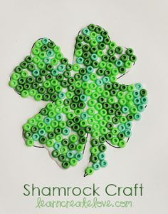 Beaded Shamrock-link includes a printable shamrock.  This could be done with colored noodles too.  This is great for fine motor development for preschoolers!