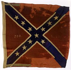 Confederate Battle Flag of the 24th Virginia Infantry.  At Gettysburg the 24th was part of Kemper's Brigade and was on the extreme right position of the line. The flag was held high by Pvt. Henry Taylor as the 24th turned south to counter the flanking fire by Stannard's Brigade. This flag was one of the few to be carried back to Seminary Ridge. The 24th's flag was later captured on April 6, 1865 at the battle of Sailors Creek, only a few days before Lee's surrender at Appomattox.