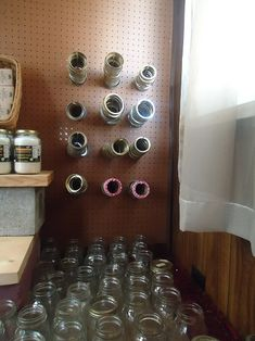 idea for organizing canning rings. maybe could use dowel rods on a board too?