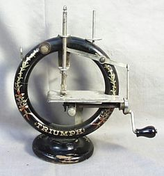 *Round Wooden Triumph Sewing Machine